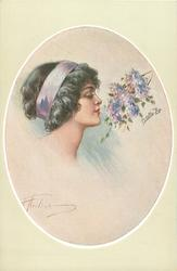 insert of pretty black haired girl, with lilac head band, looking right at lilac coloured blossom