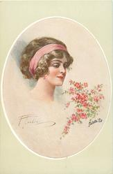 insert of pretty brunette, with pink head band, looking right at blossom