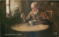 elderly man sits at table giving grace for his bowl of broth