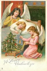 A HAPPY CHRISTMAS TO YOU  angel decorates tree beside sleeping child, another angel watches