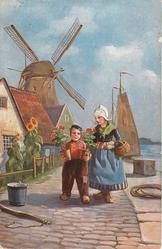 boy and girl walking along jetty, holding plant pots