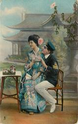 English sailor in uniform (3 stripes) sits on chair with geisha on knee