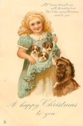 A HAPPY CHRISTMAS TO YOU  girl holding 3 puppies in her skirt, mother observes