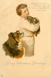 LOVING CHRISTMAS GREETINGS  boy holds two sheep-dog puppies, mother observes