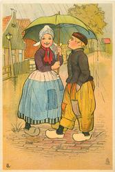 Dutch girl and boy face each other under umbrella held by girl