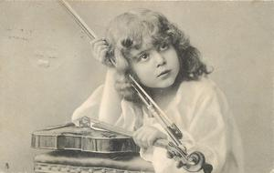 girl with violin on table