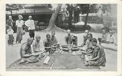 POONGYYIS (BUDDHIST PRIESTS) READING SCRIPTURES