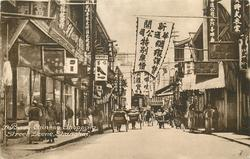 A BUSY CHINESE SHOPPING STREET SCENE