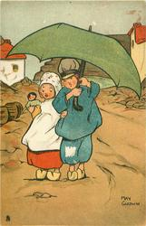 Dutch boy holding open umbrella over himself & Dutch girl with doll