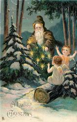 A HAPPYCHRISTMAS  two cherubs applaud Santa holding Xmas tree with lights