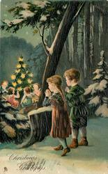 CHRISTMAS GREETINGS  woodland night scene, boy and girl watch angels around  Xmas tree