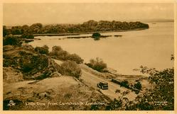 LOCH ERNE FROM CARRICKREAGH  road & car