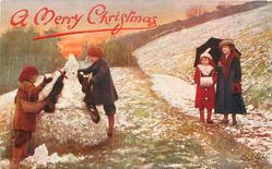 A MERRY CHRISTMAS  two boys build snowman, woman & girl under umbrella observe
