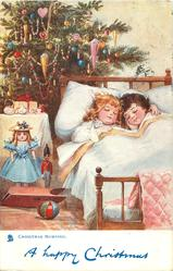 CHRISTMAS MORNING  two children asleep in bed, toys at bedside