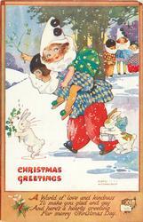 CHRISTMAS GREETINGS  boy carries girl piggy-back, rabbits around