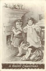 A HAPPY CHRISTMAS  three children putting up Xmas stockings