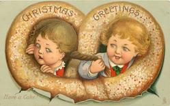 CHRISTMAS GREETINGS  boy & girl's heads in pretzel