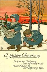 A HAPPY CHRISTMAS two children gather firewood in snow