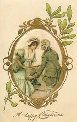 A HAPPY CHRISTMAS  silk inset lovers in old style dress, man on right, mistletoe around