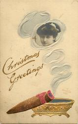 CHRISTMAS GREETINGS  smoke from cigar surrounds photo-inset of girl looking left/front