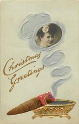 CHRISTMAS GREETINGS  smoke from cigar surrounds photo-inset of girl looking right/front