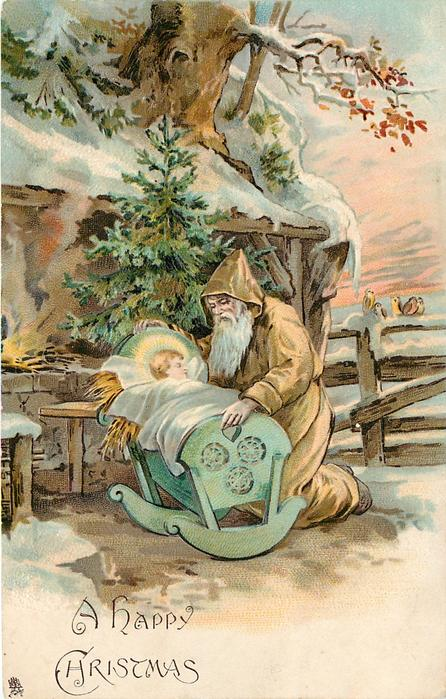 A HAPPY CHRISTMAS gold robed Santa kneels by baby Jesus in a cot - TuckDB