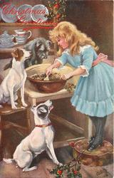 girl stirring Xmas fare while three dogs watch