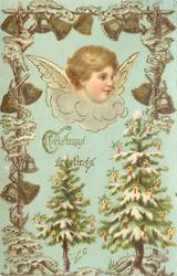 CHRISTMAS GREETINGS  head of angel facing right, Christmas trees, bells, in ornate surround