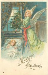 A HAPPY CHRISTMAS  angel in green holds Xmas tree & hovers over sleeping child