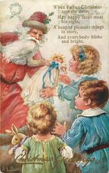 CHRISTMAS GREETINGS  Santa holds doll, 3 children front right