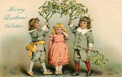 LOVING CHRISTMAS WISHES  girl wearing pink stands under mistletoe held up by two boys