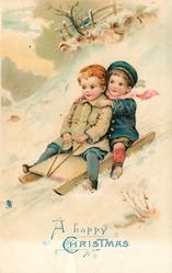 A HAPPY CHRISTMAS  2 children sledding down-hill