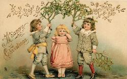 A HAPPY CHRISTMAS  girl wearing pink stands under mistletoe held up by two boys