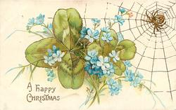 A HAPPY CHRISTMAS  forget-me-nots in front of clover leaves, spider & web top right
