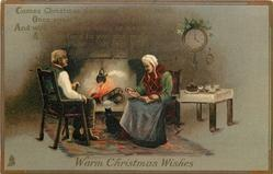 WARM CHRISTMAS WISHES  cat between elderly couple at fireside