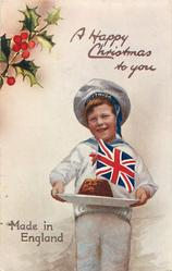 A HAPPY CHRISTMAS TO YOU  boy carries Xmas pudding topped with flag