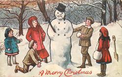 children surround snowman