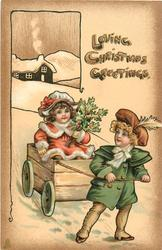 LOVING CHRISTMAS GREETINGS  young boy pulls girl in cart