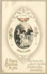 GREETINGS  man stands behind seated woman, roses in surround