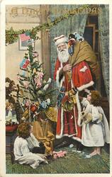 A HAPPY CHRISTMAS  tree left, Santa right with golly; girl sitting and looking at him, other girl right