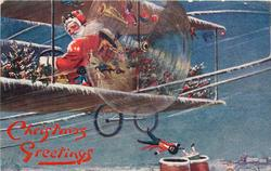 CHRISTMAS GREETINGS  blue background, Santa drives plane left, golly & doll fall down chimneys