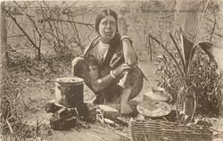 A BRAHMAN WOMAN COOKING FOOD