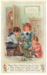 WHEN FATHER CHRISTMAS TAPS THE DOOR MAY HAPPY FACES MEET HIS SIGHT, A HEAP OF PLEASANT THINGS IN STORE AND EVERYBODY BLITHE AND BRIGHT  Santa peeks at children with holly