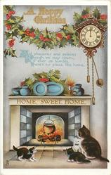 A HAPPY CHRISTMAS  cat & 3 kittens before fire