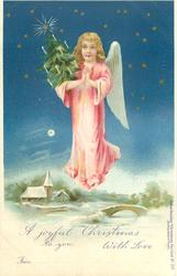 angel in pink flying over wintery river & church carrying small Xmas tree