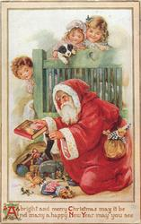 Santa kneeling, book in his right hand, three children on bed behind