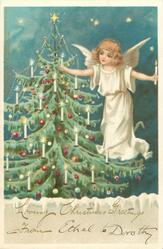 angel to right of tree, blue sky with stars
