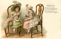 MERRY CHRISTMAS GREETINGS  two overdressed girls take tea