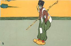 fisherman standing facing left, smoking pipe, in yellow clogs