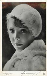 JESSIE MATTHEWS  head & shoulder study, she faces left, looks front, wears feather hat & fur